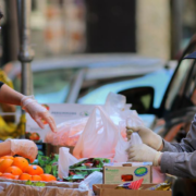 A street vendor sold fruits and vegetables on Beach Street in Chinatown. // LANE TURNER FROM GLOBE STAFF