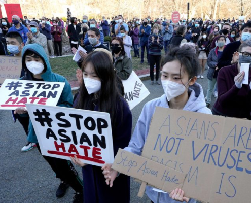 Protesters during a rally held to support Stop Asian Hate in Newton, Mass., on March 21. (AP Photo/Steven Senne)